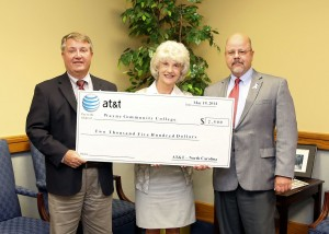 AT&T Regional Director for External Affairs John Lyon presents a check for $2,500 to WCC President Kay Albertson and Wayne County Commissioner Bill Pate (l-r). The money will be used by the Foundation of Wayne Community College to fund scholarships for veterans.