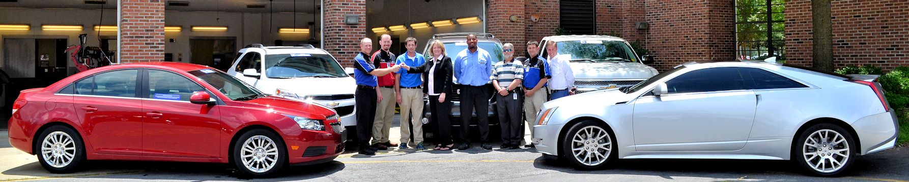 General Motors District Manager-After Sales Marjorie Duff and CCOG Service Manager Michael Vincent (center) turn over the keys to five vehicles for use in Wayne Community College's Automotive Systems Technology Program. Accepting the donation are (left to right) GM-ASEP Coordinator David Byrd, Instructor Bryant Keel, Instructor Kevin Jordan, Applied Technologies Division Chair Ernie White, Instructor Kevin Jordan, and Transportation Department Chair Craig Foucht.