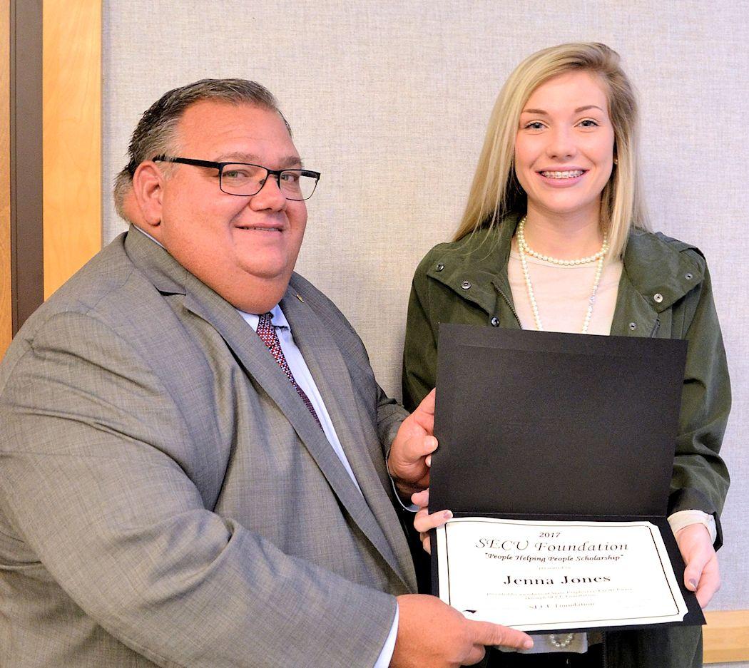 SECU local advisory board member presents a certificate to aWCC student.