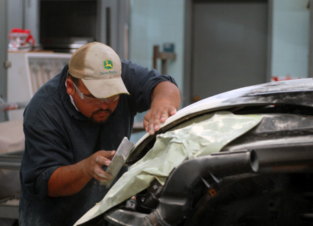 image of student working on car