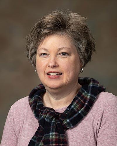 Portrait of Lisa Taylor.