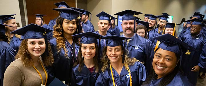 WCC students in graduation robes.