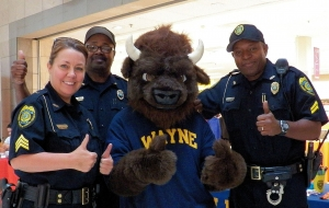 Goldsboro Police Department Officers and Billy Bison give WCC two thumbs up.