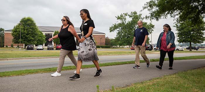 Employees walking.